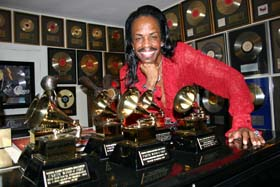 Verdine White surrounded by Grammy awards